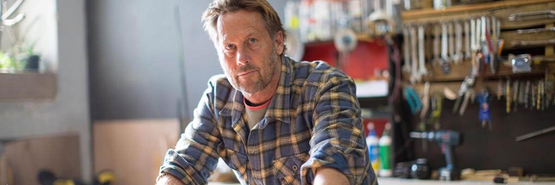 Man wearing squared shirt looking at the camera