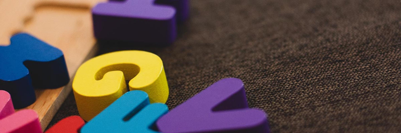 Wooden alphabet blocks on carpet
