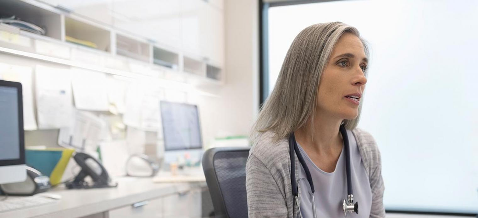 Doctor in clinic looking in front of her