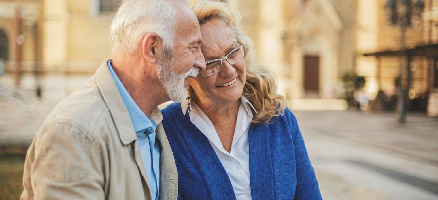 Older couple outside, smiling together