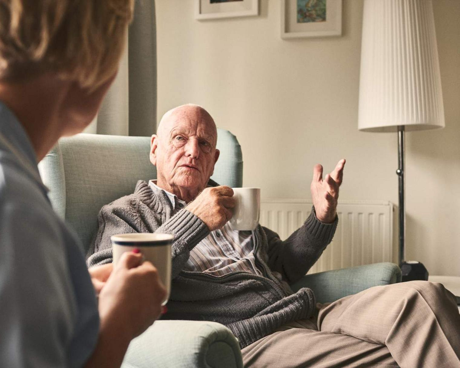 Older male patient chatting with nurse