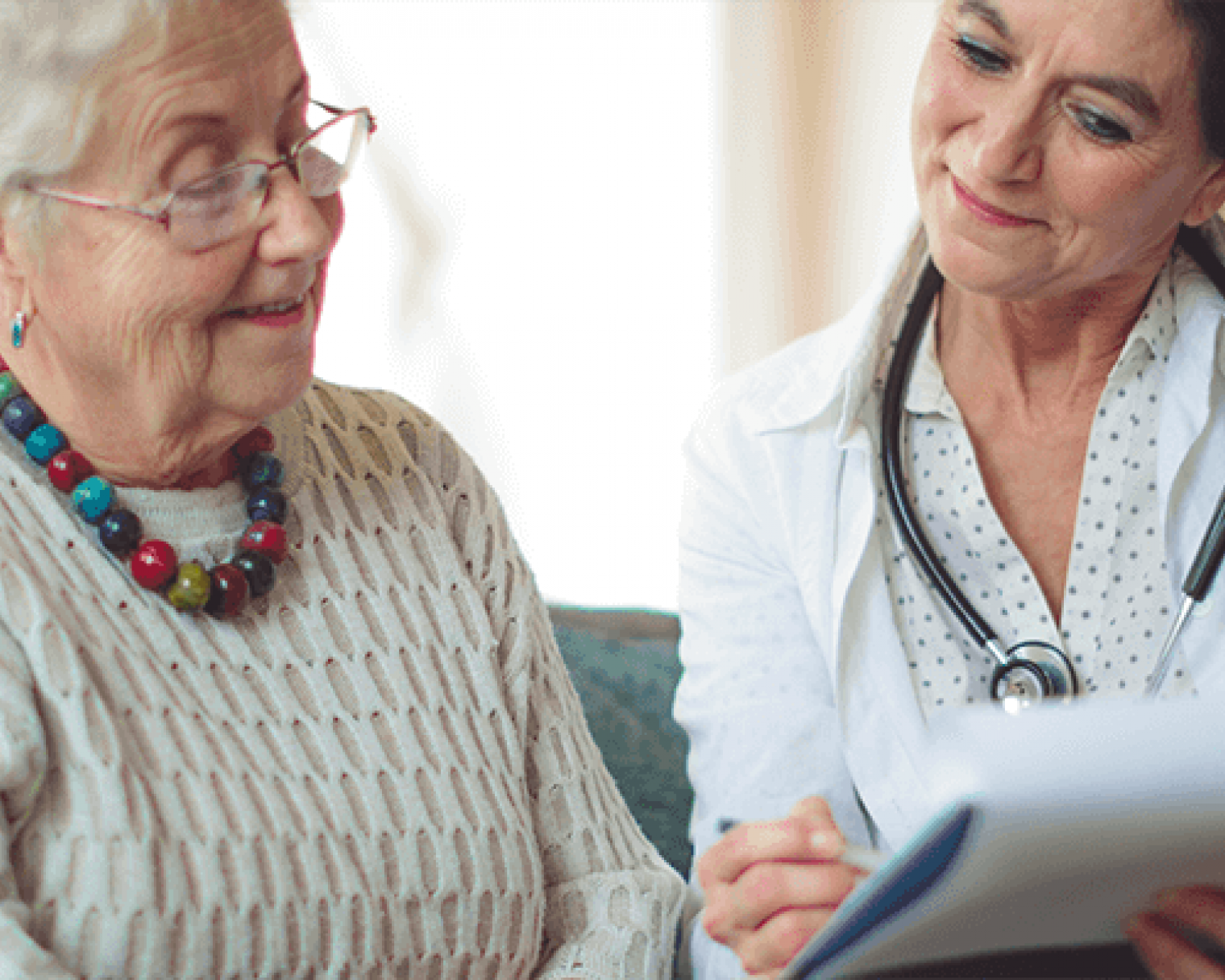 Doctor and elderly female patient reviewing results