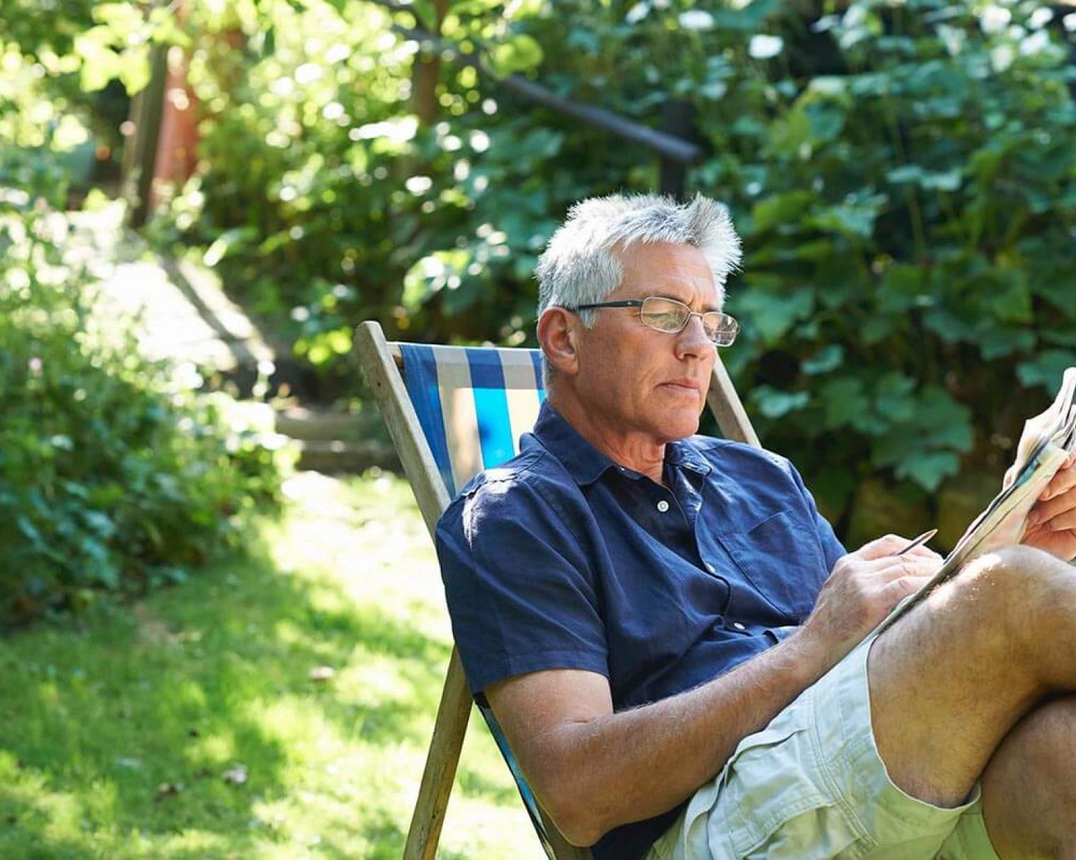 Middle aged man reading with glasses