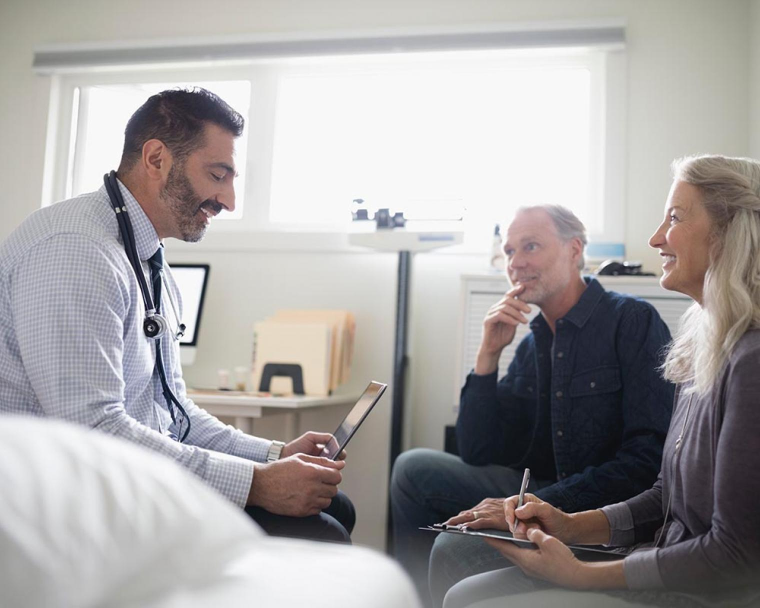 Doctor using iPad in front of patients