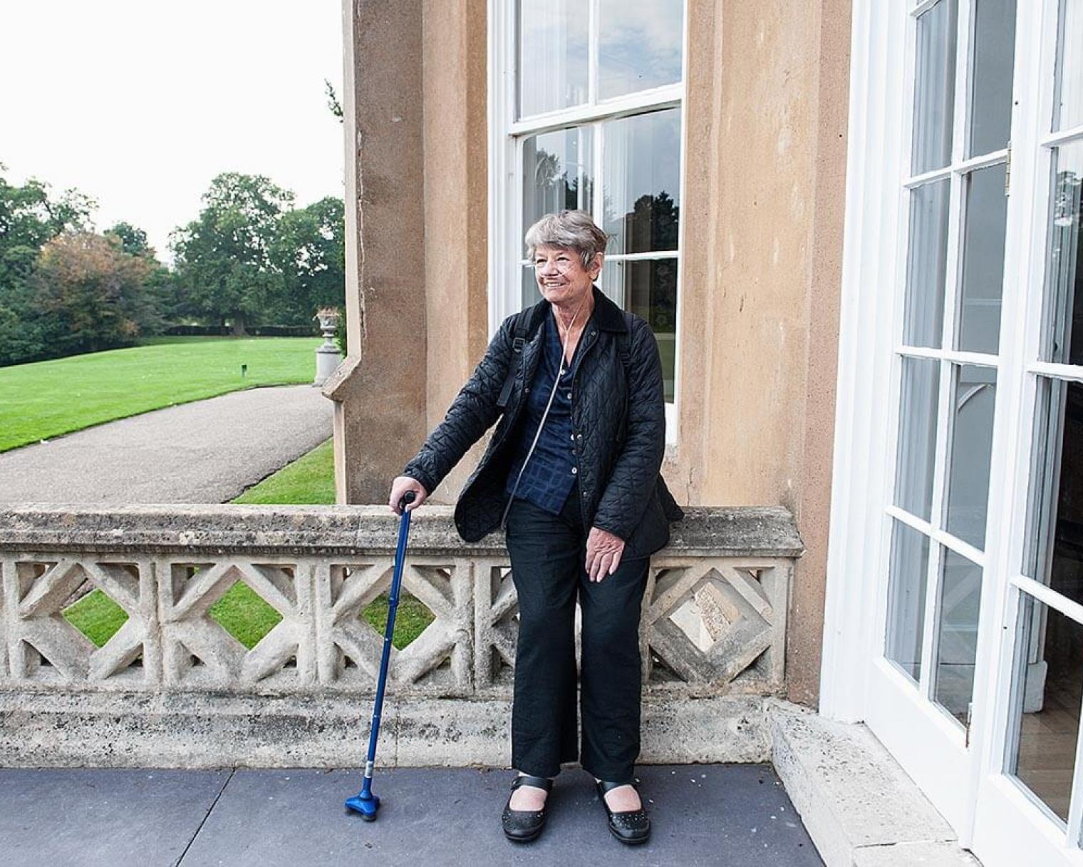 Elderly lady using oxygen tubes whilst walking around