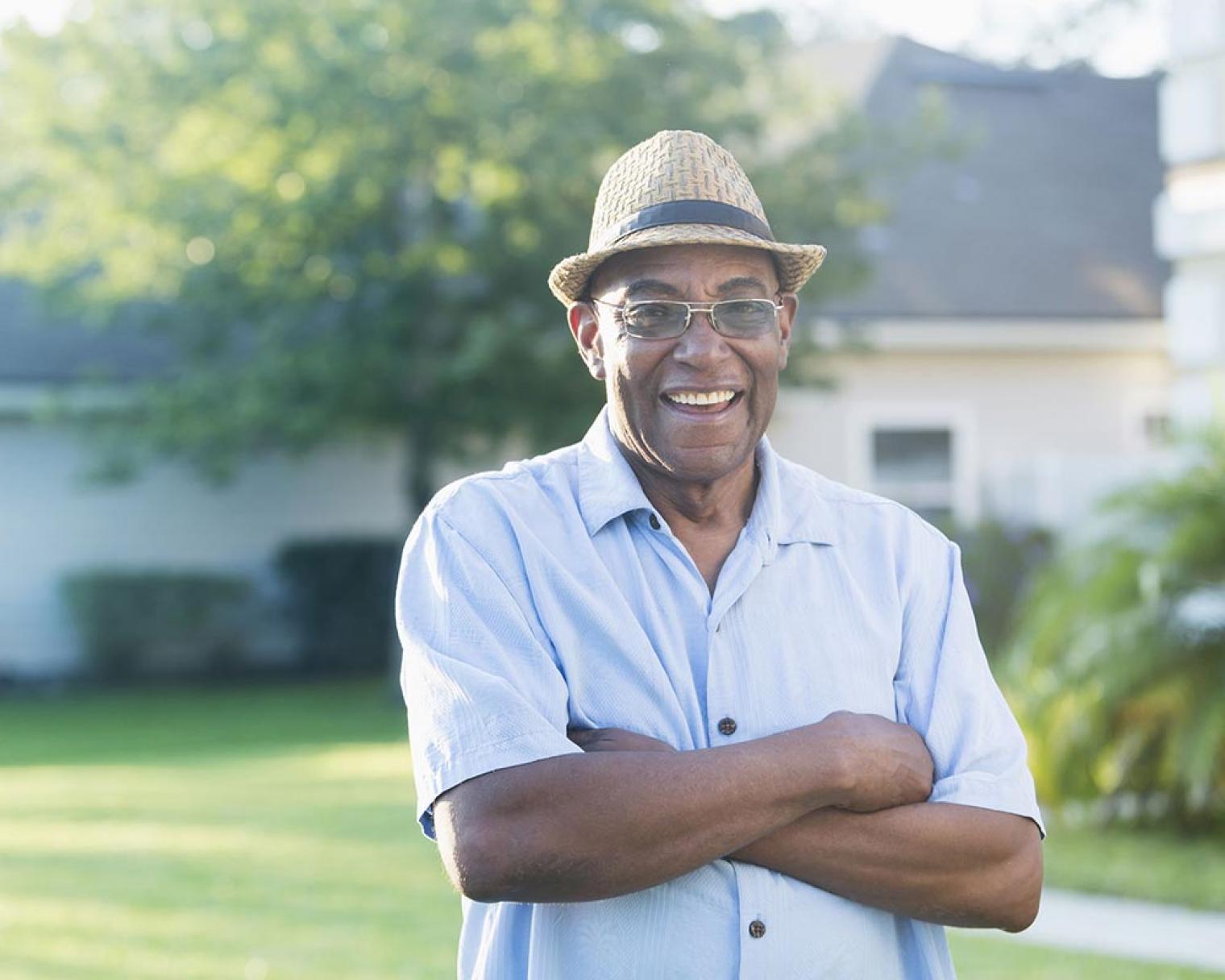 Smiling man standing in a garden